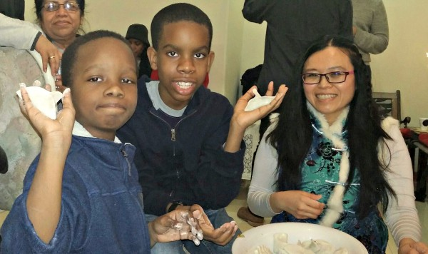 my sons making dumplings at a Chinese New Year party